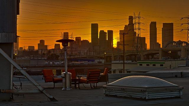 la filming and photo studio with rooftop access for 360 view of golden hour downtown cityscape skyline view