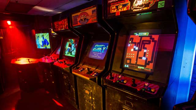 arcade game room with working vintage machines in downtown los angeles warehouse film photography production shooting space