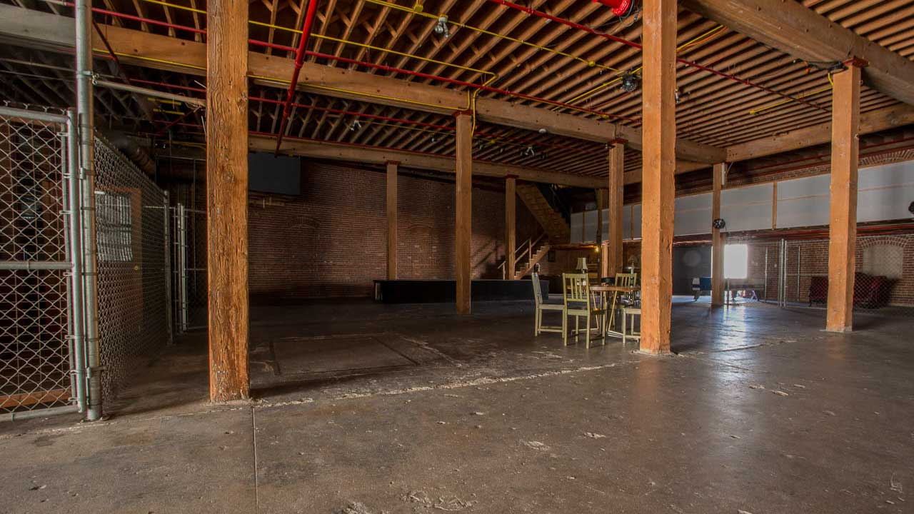 wood industrial warehouse rafters and pillars with natural light for film and photography production shooting in downtown los angeles warehouse studio