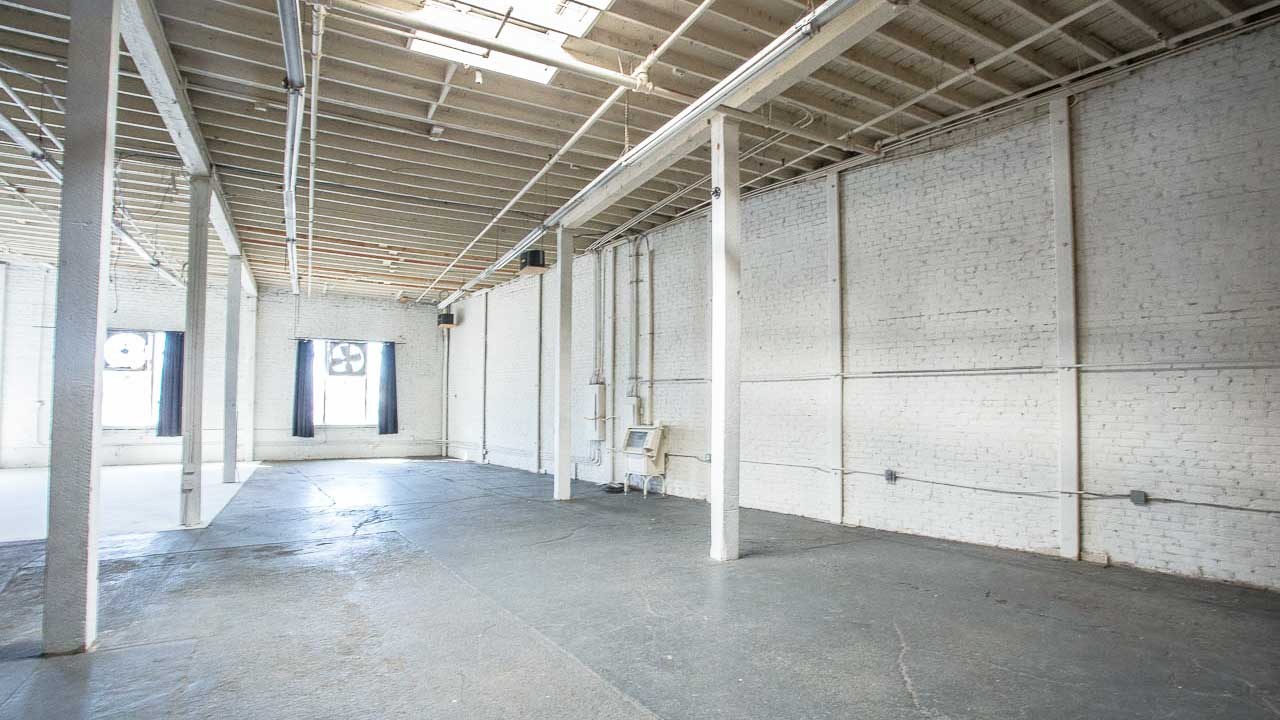 white brick modern industrial texture open warehouse space available for filming and photo shoots in los angeles