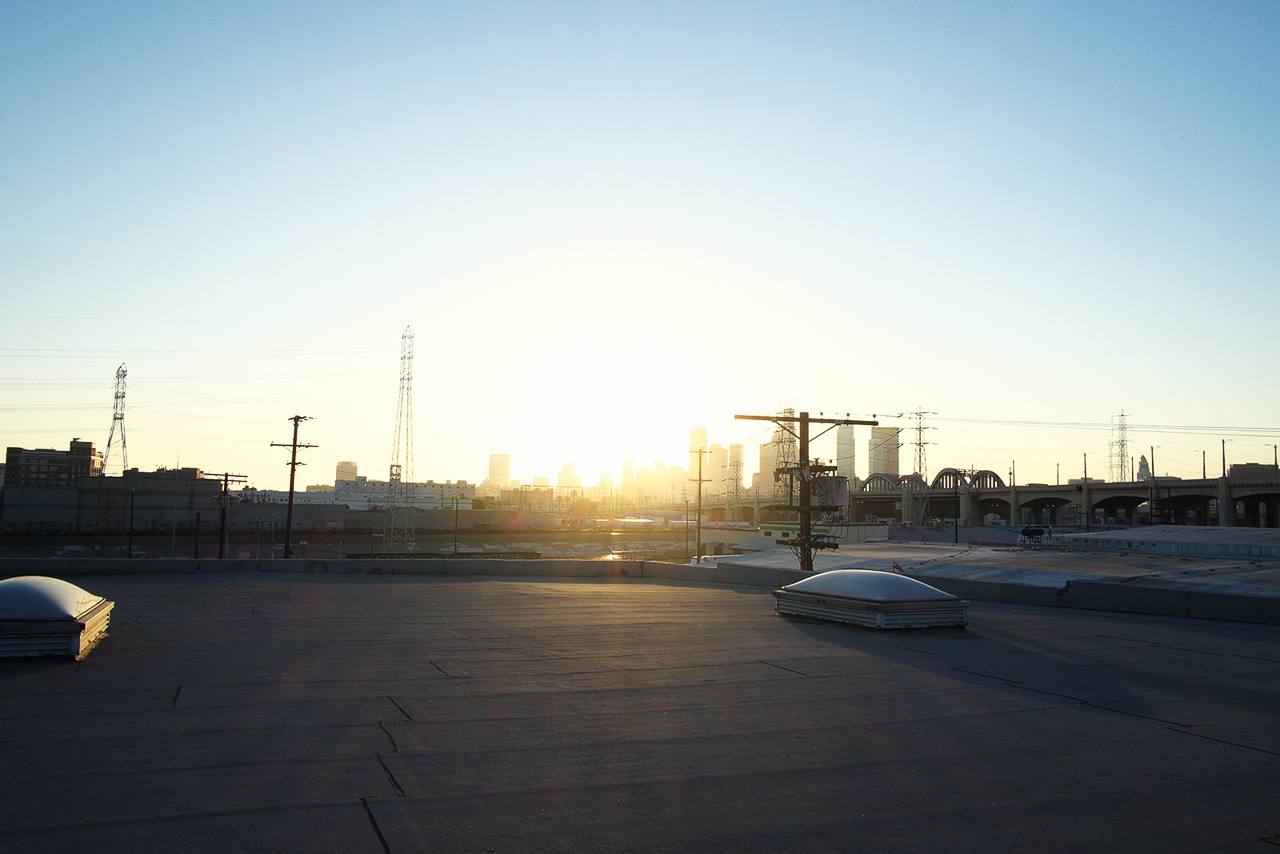 open space warehouse rooftop with golden hour skyline cityscape view in dtla for film and photography shooting productions