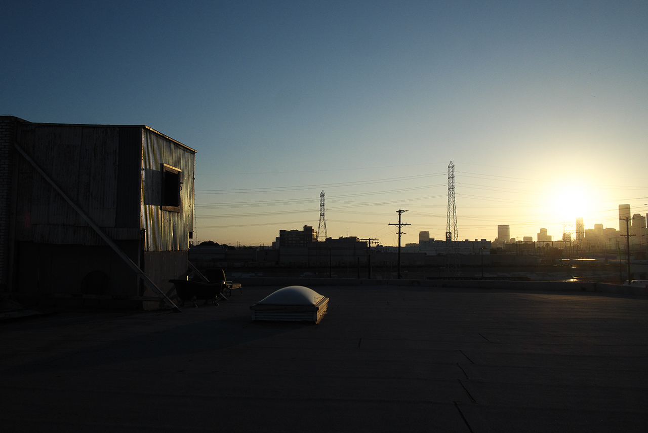 la studio with spacious rooftop with golden hour skyline cityscape view of los angeles buildings