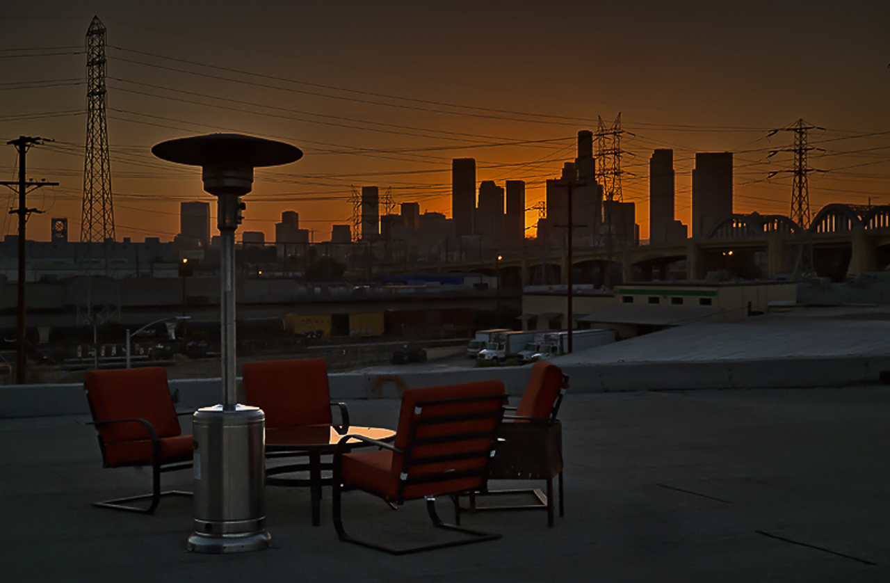 urban industrial los angeles location with warehouse rooftop with golden hour downtown los angeles city skyline cityscape view