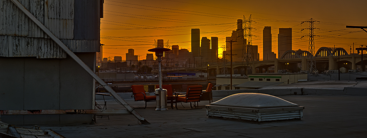 epic rooftop skyline cityscape with golden hour view of city for rent in downtown los angeles warehouse