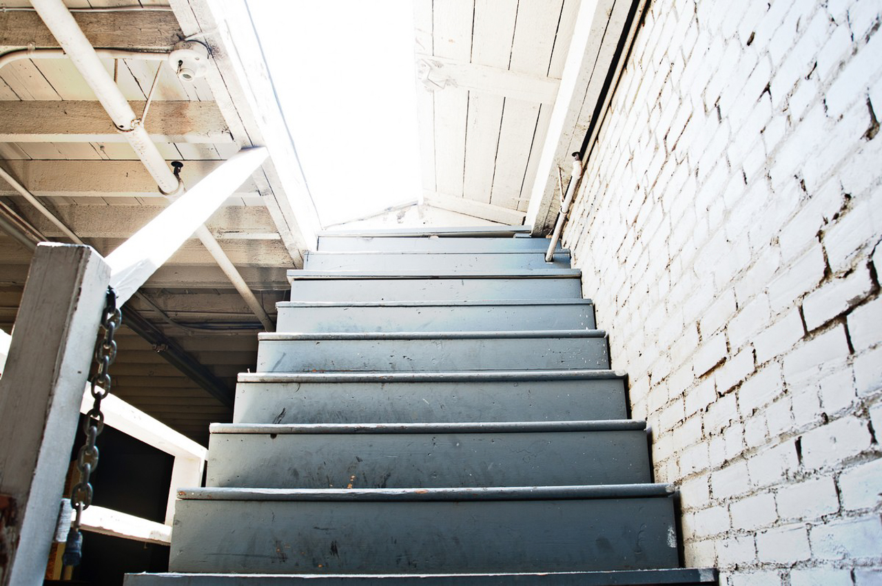 urban industrial warehouse stairway leading to rooftop city skyline location los angeles for film and photography shooting