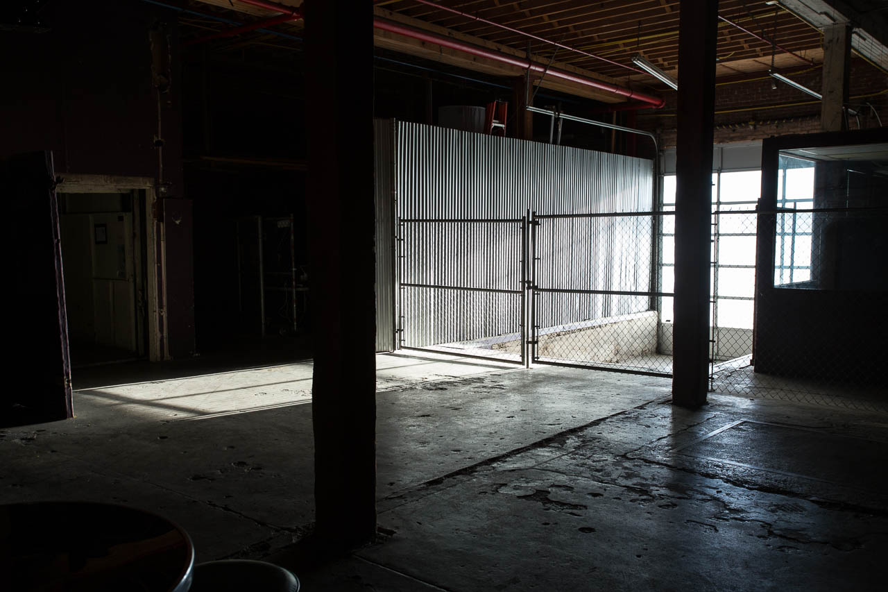 industrial warehouse loading dock with corrogated metal roll up door windows and concrete floors for film and photography shoots located in downtown los angeles