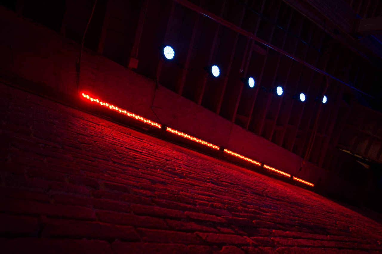 brick wall with led stage lighting in film and photo studio in metropolitan la