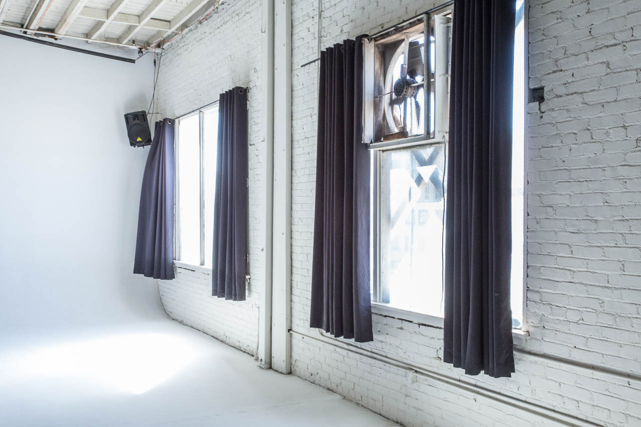 film art and photography warehouse space with white cyc and natural sun light for rent in downtown los angeles studio