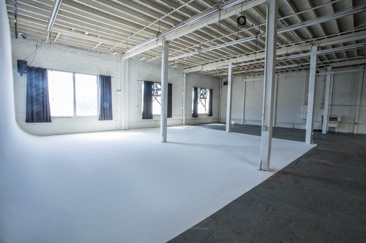 film and photo studio in la with white cyc wall and natural sun light in downtown los angeles film and photo warehouse studio