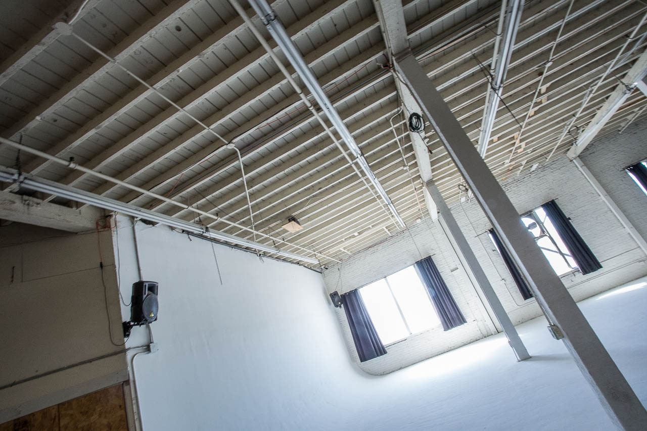 white cyc wall with sun light at affordable rates for film and photography production in downtown los angeles warehouse