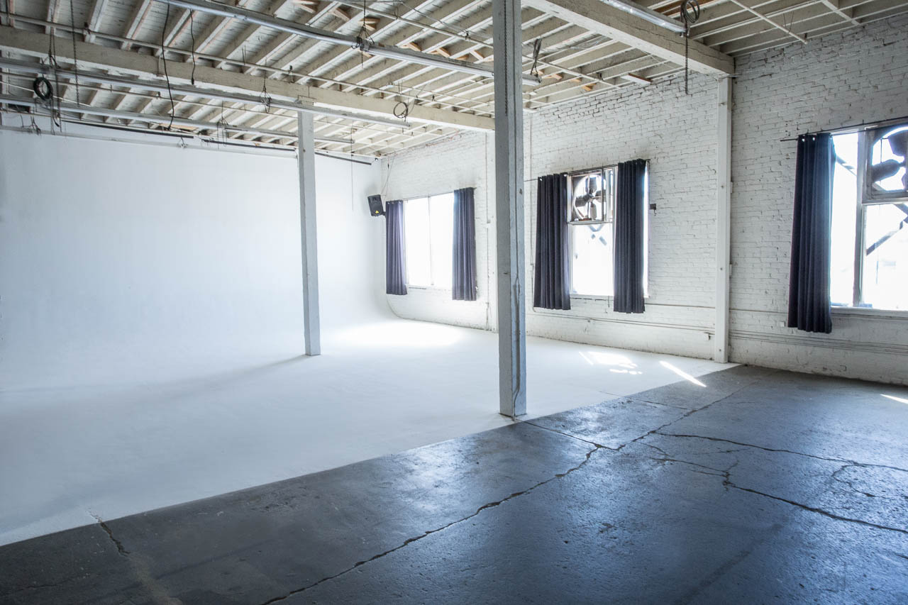 los angeles warehouse space with white cyc wall and sunlight for film and photography production