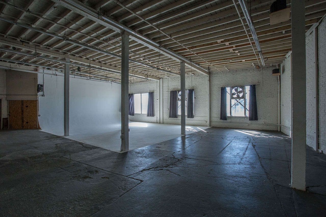 downtown los angeles warehouse with white cyclorama for dark gritty film and photo production