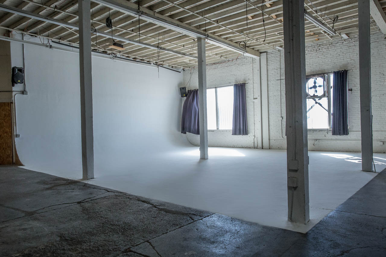 film studio with white cyc and natural light for photographer and film makers in downtown los angeles warehouse